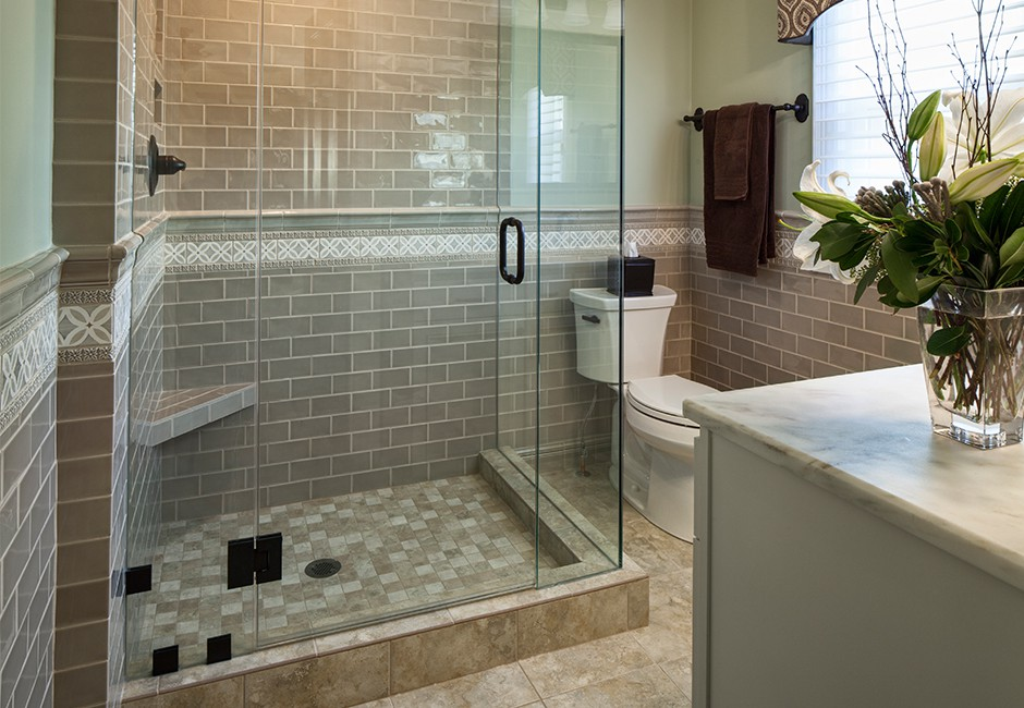 a view of a bathroom with a glass walk-in shower