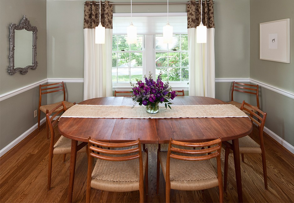 view of a dining room table and chairs