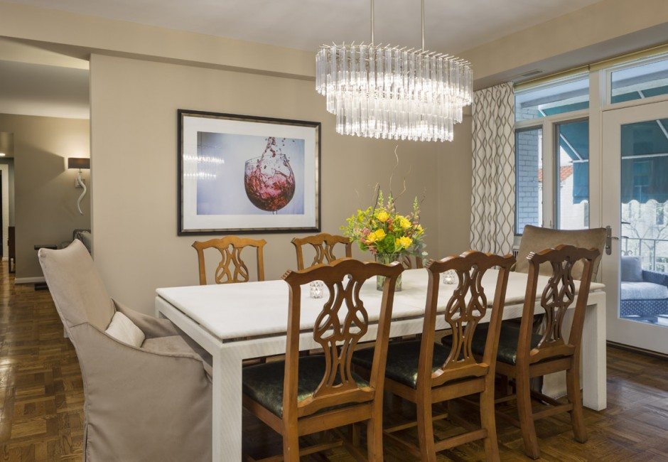 dining room with a chandelier and a view of outside