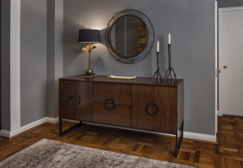 entryway with a mirror and decorative furniture