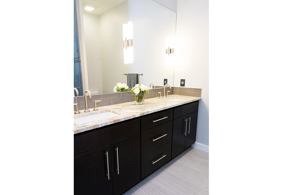 view of a bathroom vanity and mirror