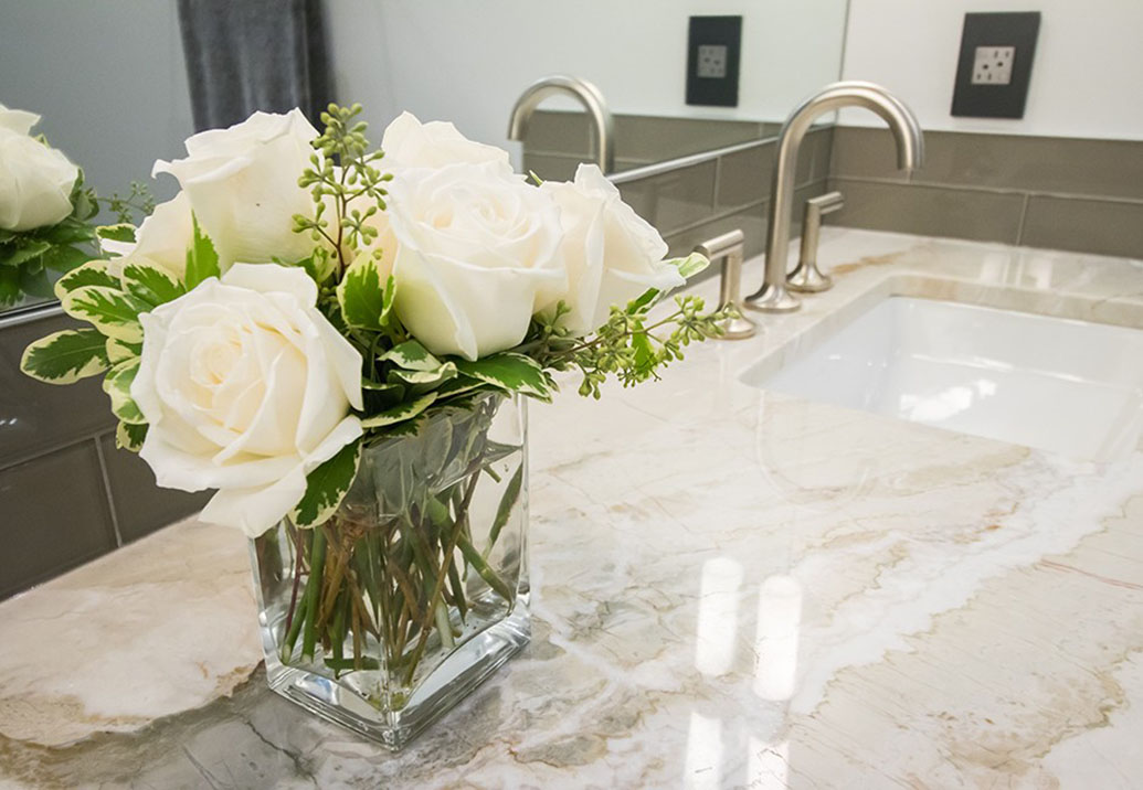 closeup view of flowers in a vase on a bathroom counter
